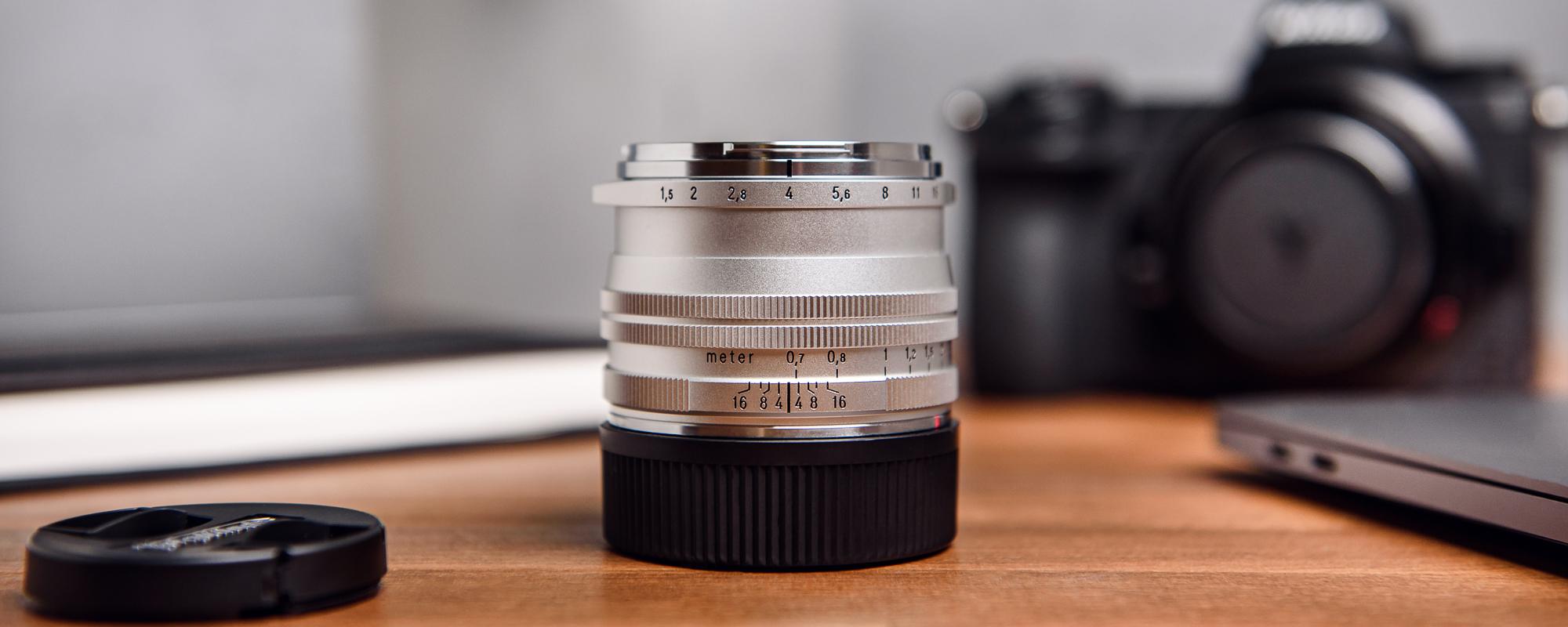Voigtlander Nokton II 50 mm f/1.5 lens for Leica M - MC, silver - on desk