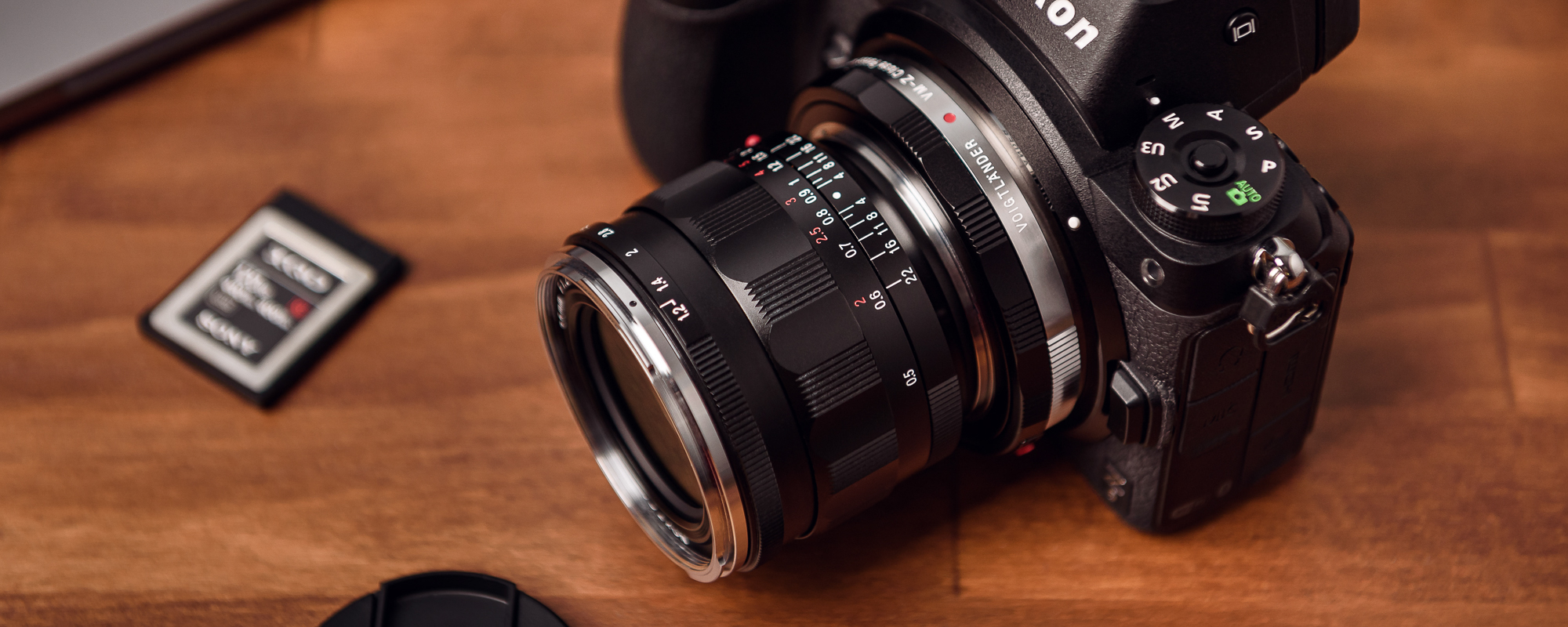 Voigtlander Nokton III 35mm f/1.2 lens for Leica M on wooden desk attached to Nikon Z6 with adapter