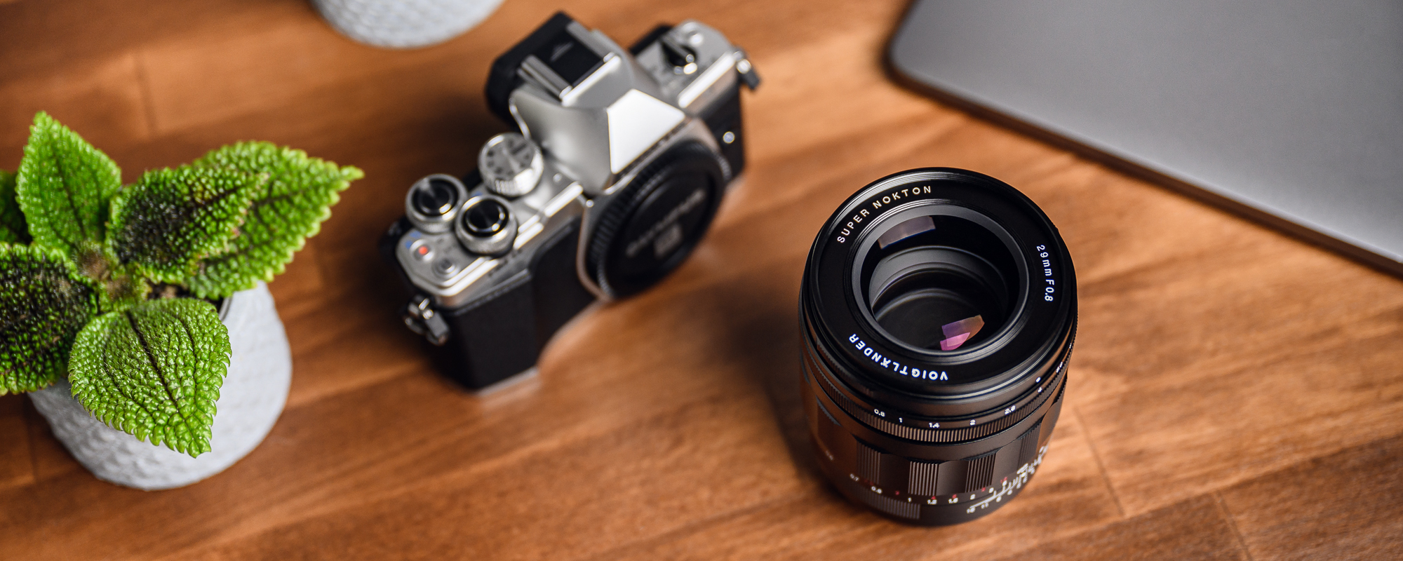 Voigtlander Super Nokton 29mm f/0.8 lens for Micro 4/3 on desktop