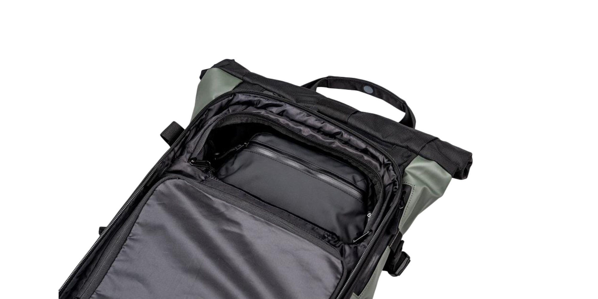 Wandrd Tech Pouch Large in the top compartment of the Prvke backpack